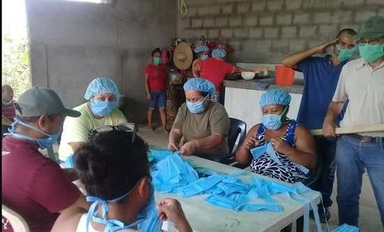 Venezuelan communes and communal councils produce PPE and distribute it freely to those in need